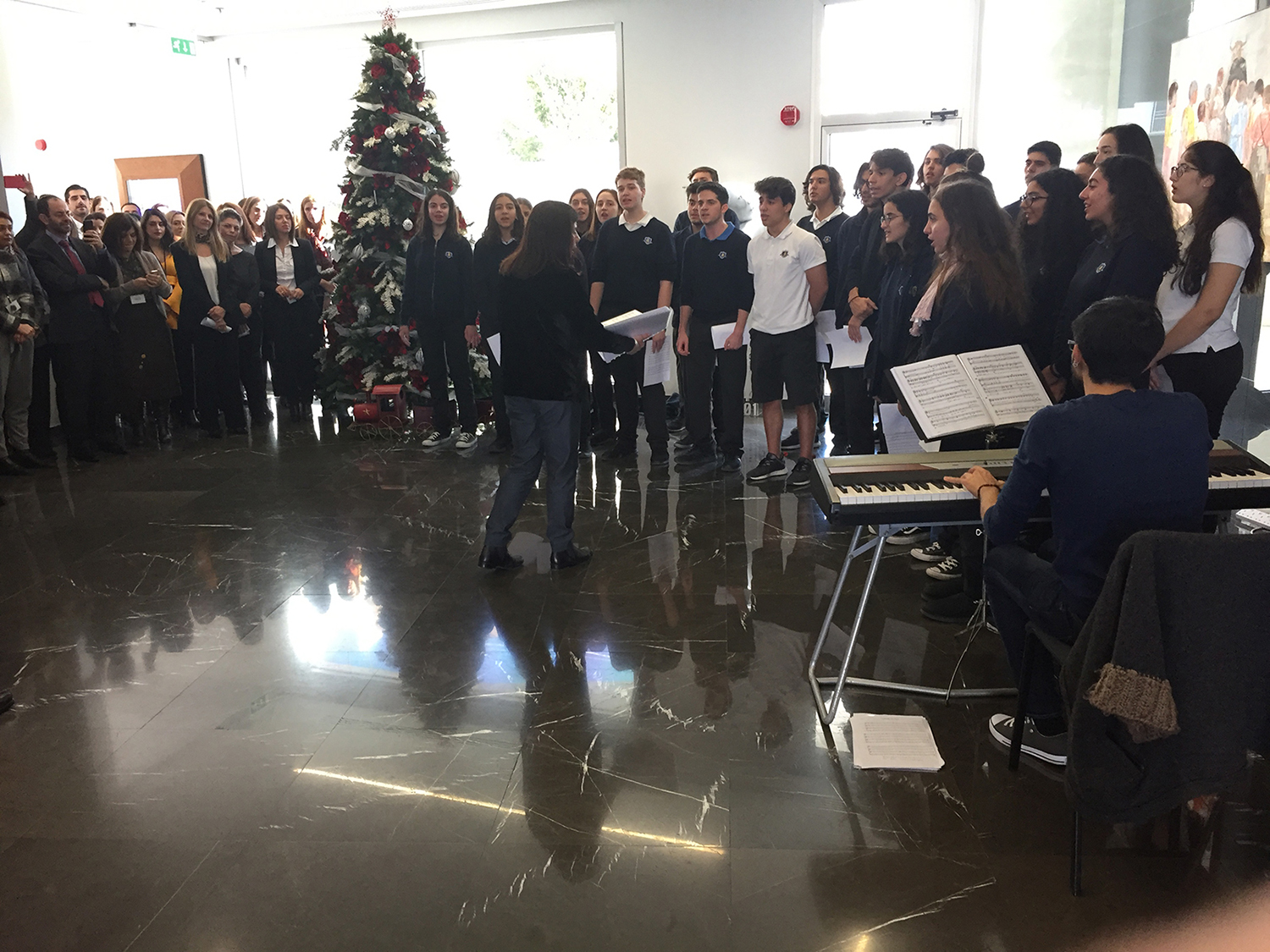 Christmas melodies from the English School choir, at CNP CYPRUS headquarters
